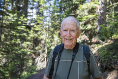 Senior active man. Standing in forest stock photo