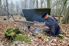Senior Active Man Camping In Woods With Yerba Drink Royalty Free Stock Photography