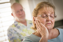 Senior Adult Couple in Dispute or Consoling Stock Photo