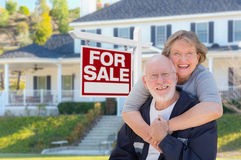 Senior Adult Couple in Front of Real Estate Sign, House Stock Photos