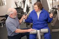 Senior Adult Couple in the Gym. Senior Adult Couple Working Out in the Gym royalty free stock photography