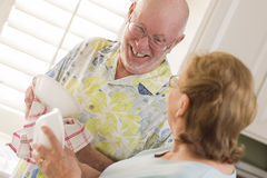 Senior Adult Couple Washing Dishes Together Inside Kitchen Royalty Free Stock Images
