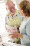 Senior Adult Couple Washing Dishes Together Inside Kitchen Stock Photography