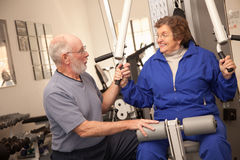Senior Adult Couple Working Out Together in the Gym Stock Photography