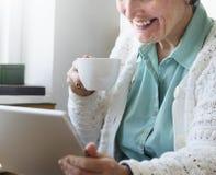 Senior Adult Drinking Water Mug Concept Stock Image