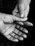 Senior aged hands on a black background Royalty Free Stock Photography