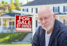 Senior Adult Man in Front of Real Estate Sign, House Stock Photo