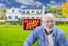 Senior Adult Man in Front of Real Estate Sign, House Royalty Free Stock Photography