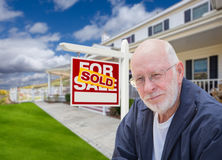 Senior Adult Man in Front of Real Estate Sign, House Stock Photography