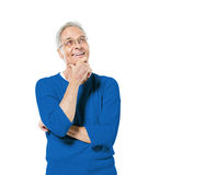 Senior Adult Man Standing and Thinking. Senior Adult Man Standing With His Hand On His Chin Smiling And Comtemplating Royalty Free Stock Images