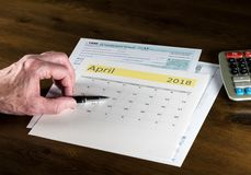 Senior adult man with tax return date of April 17, 2018 stock photo