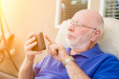 Senior Adult Man Texting on Smart Cell Phone. Royalty Free Stock Image