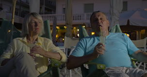Senior adult man and woman drinking cocktails stock video