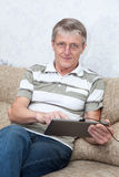 Senior adult man working with new tablet computer Royalty Free Stock Photo