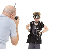 Senior adult photographer shooting punk kid over white background Royalty Free Stock Photos