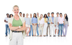Senior Adult Standing Out from Crowd Royalty Free Stock Photos