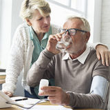 Senior Adult Taking Pills Medicine Concept stock photos
