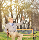 Senior adult taking a selfie in park Stock Photo