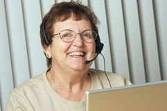 Senior Adult with Telephone Headset Stock Photos