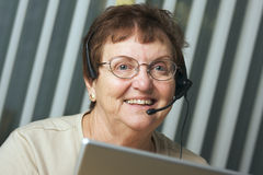 Senior Adult with Telephone Headset Royalty Free Stock Photography