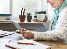 Senior Adult using Digital Device Tablet Concept Royalty Free Stock Photo