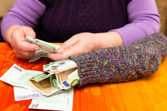 Free Senior Adult With A Sock Full Of Money Royalty Free Stock Image - 49412306