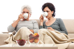 Senior adult woman drinking coffee Stock Image
