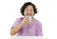 Senior adult woman drinking soy milk Royalty Free Stock Images
