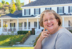 Senior Adult Woman in Front of House Stock Photography