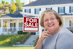 Senior Adult Woman in Front of Real Estate Sign, House Stock Images