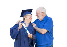 Senior Adult Woman Graduate in Cap and Gown Being Congratulated Stock Images