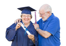 Senior Adult Woman Graduate in Cap and Gown Being Congratulated Royalty Free Stock Photography