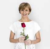 Senior Adult Woman Smiling Happiness Flower Studio Portrait stock photo