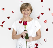 Senior Adult Woman Smiling Happiness Flower Studio Portrait Royalty Free Stock Photography