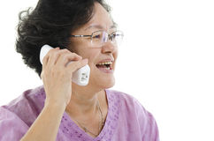 Senior adult woman talking on phone Royalty Free Stock Image