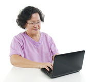 Senior adult woman using laptop computer Stock Photography