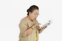 Senior Adult Women Hold Calculator Concept stock photography