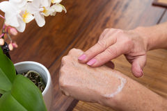 Senior Adults Hands With Lotion Royalty Free Stock Photos