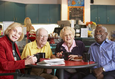 Senior adults having morning tea together Stock Photo