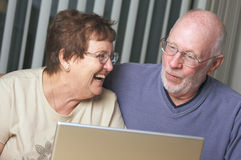Senior Adults on Laptop Computer Stock Images