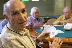 Senior adults playing bridge stock images