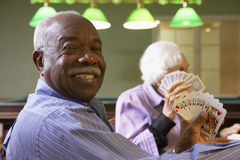 Senior adults playing bridge Stock Photo