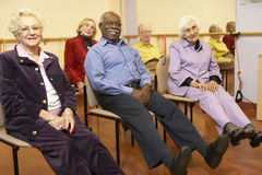Senior adults in a stretching class royalty free stock image