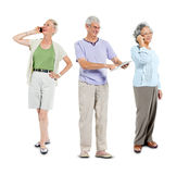 Senior Adults using communication device Stock Photography