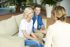 Senior advisor and her clients Royalty Free Stock Images