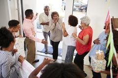 Free Senior African American  Couple Arriving Home To A Family Surprise Party, Elevated View Stock Images - 144593604