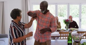 Senior african american couple dancing in a kitchen