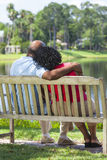 Senior African American Couple On Park Bench Stock Photo