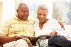 Senior African American couple reading Stock Image