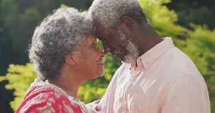 A senior african american couple spending time together in the garden in love social distancing in q